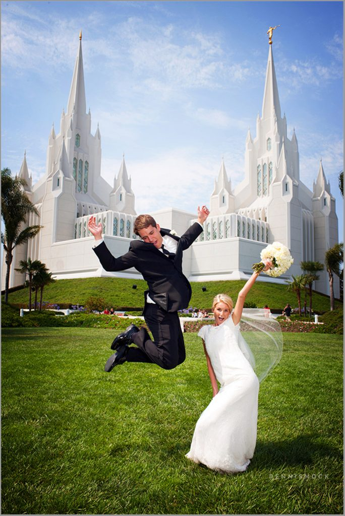 bride and groom show their excitement after getting married at the san diego LDS Temple