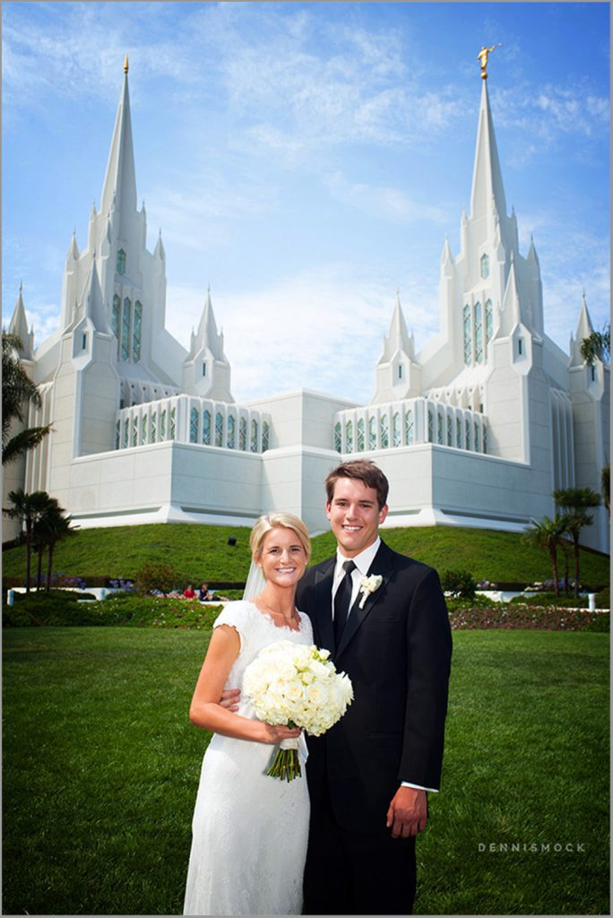 lovely posed wedding couple with the san diego temple in the background