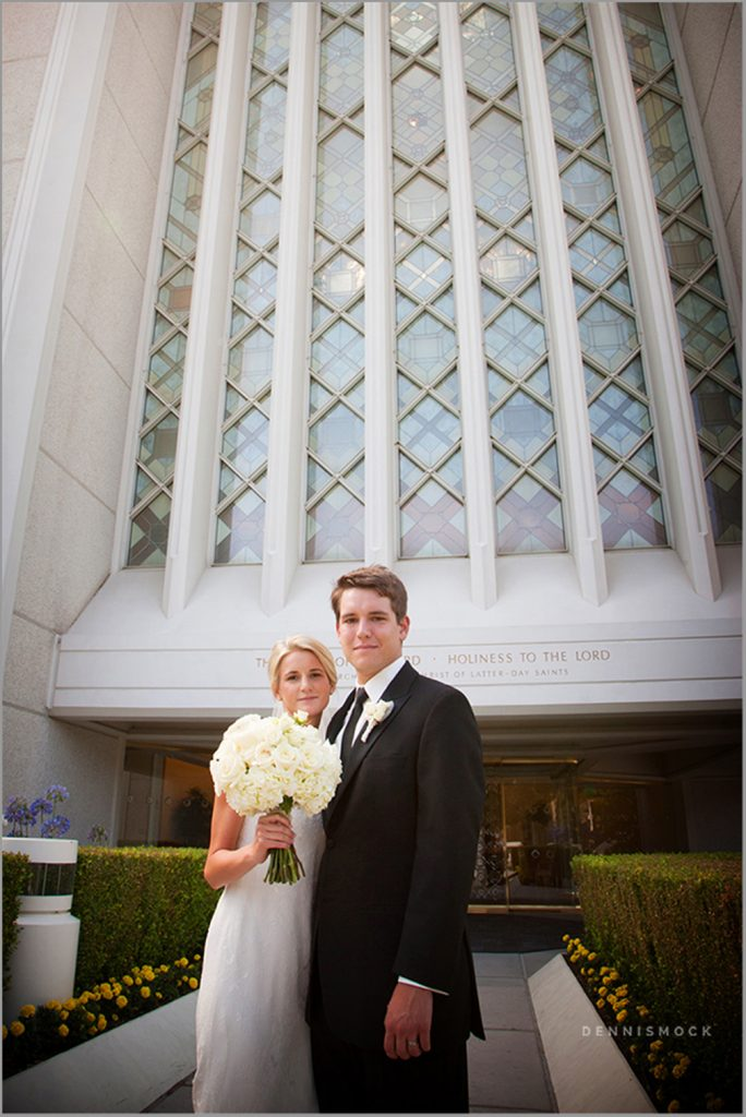 modern couple posed with the grand architecture of the LDS Temple in San Diego California