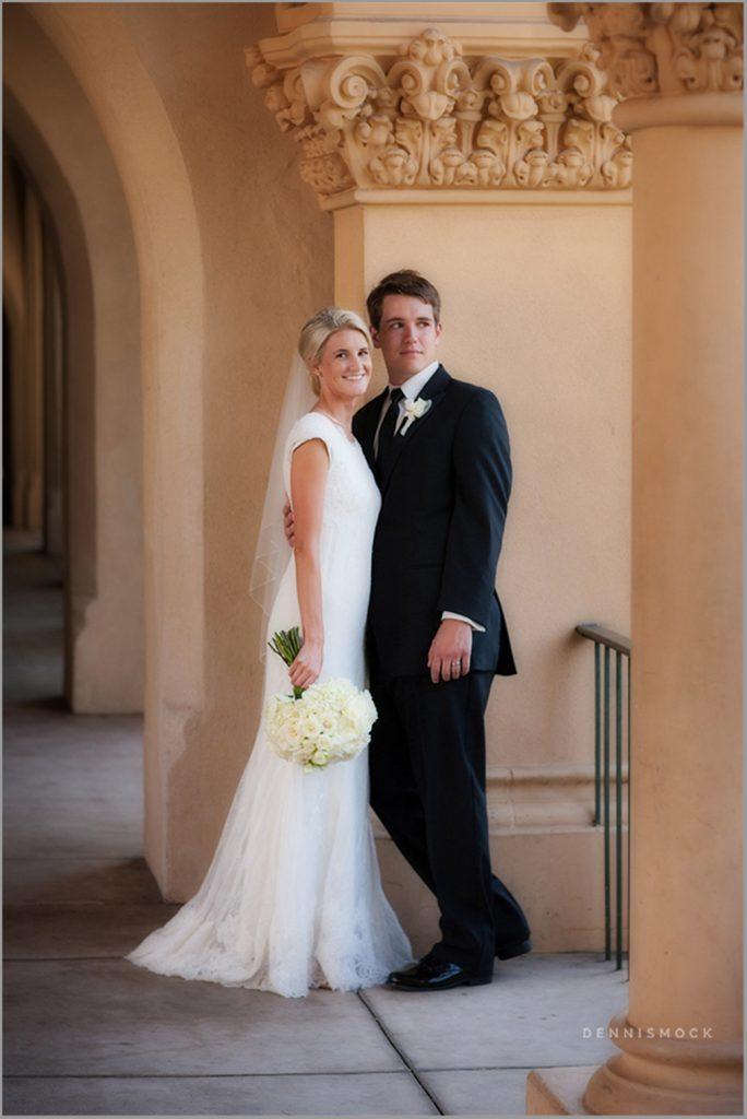 wedding couple pose using the architecture of balboa park