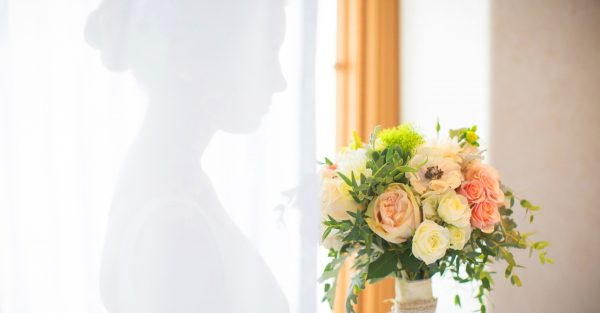 quiet moment as bride receives her flowers