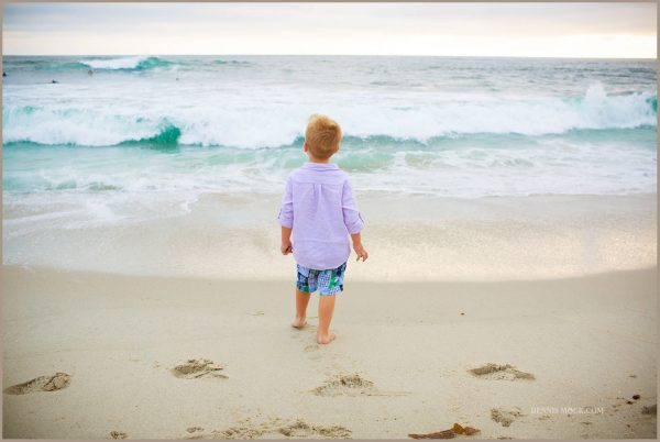little boy watching the surfers at San Diego beach