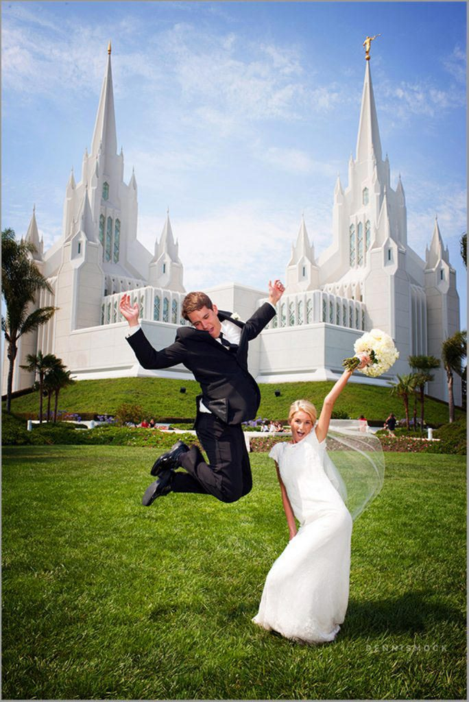 celebrating groom jumping in the air at the San Diego LDS Temple Wedding by Dennis Mock Photography