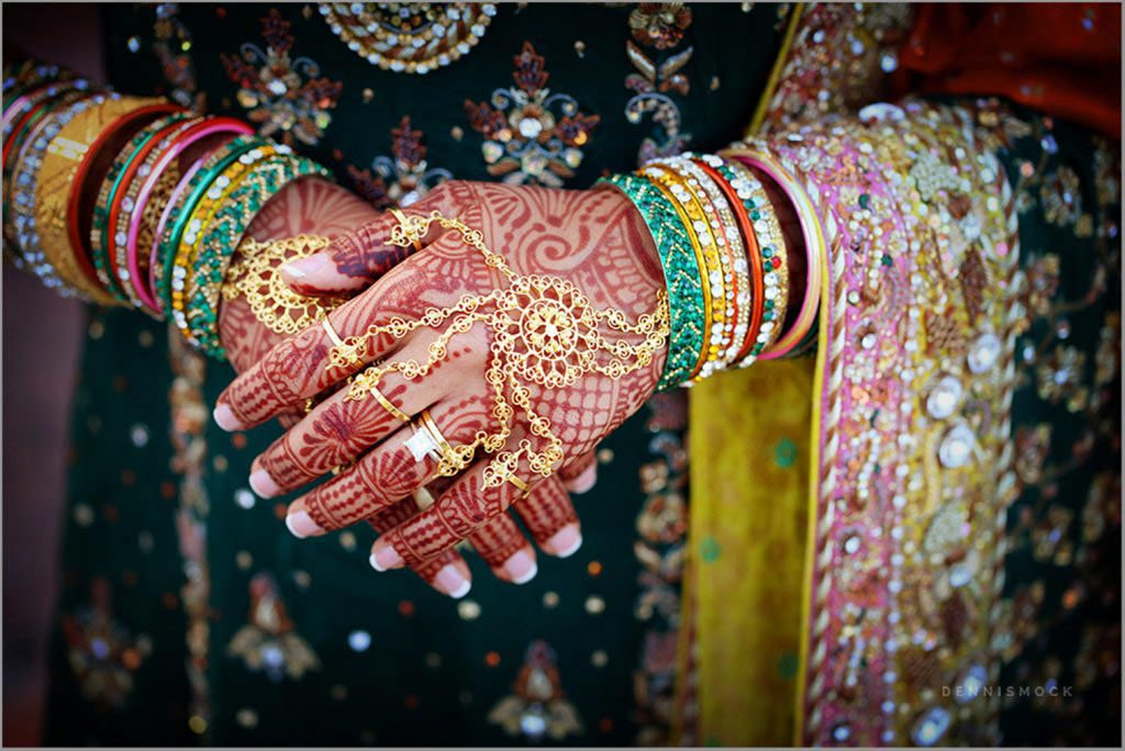 hands of an Indian bride beautiful details and colors by photographer Dennis mock San Diego