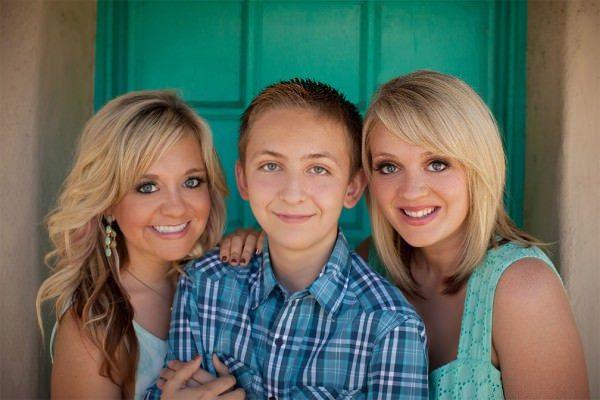 family portrait taken at Balboa park by photographer Dennis mock in San Diego