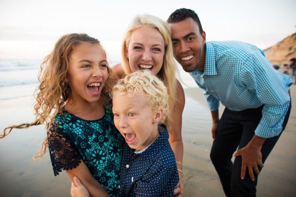 fun family portrait session at the beach in Torrey pines state beach located in La Jolla California
