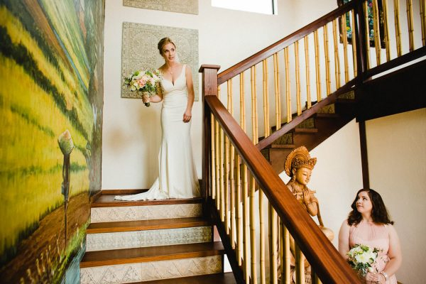 bride walks down staircase for first look at La Jolla Hotel