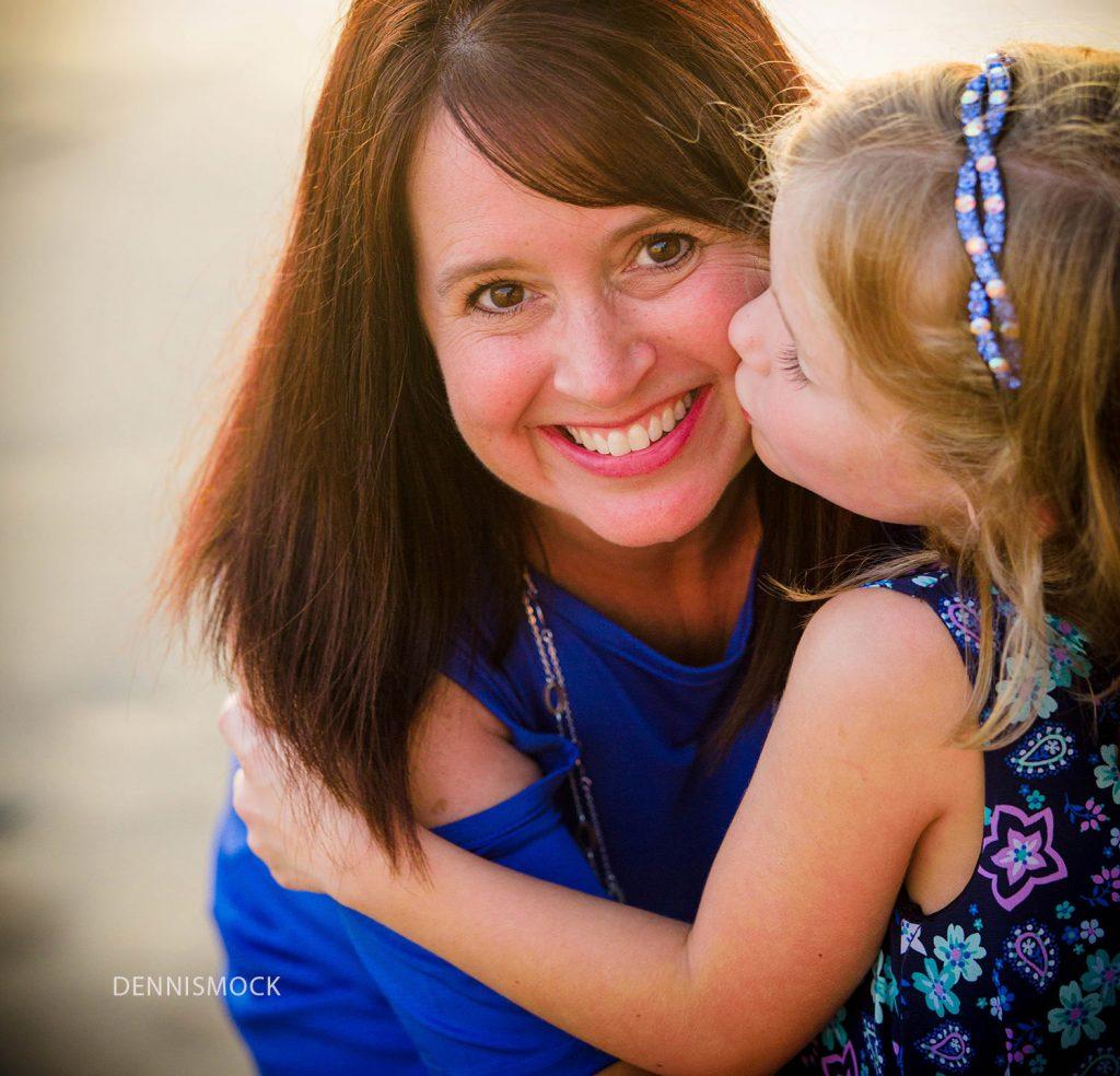 Kisses for my mom brings smiles at La Jolla Family photographer Dennis Mock