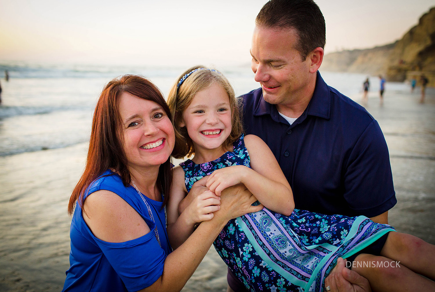 family giggles and laughs during family beach portrait session in La Jolla California.
