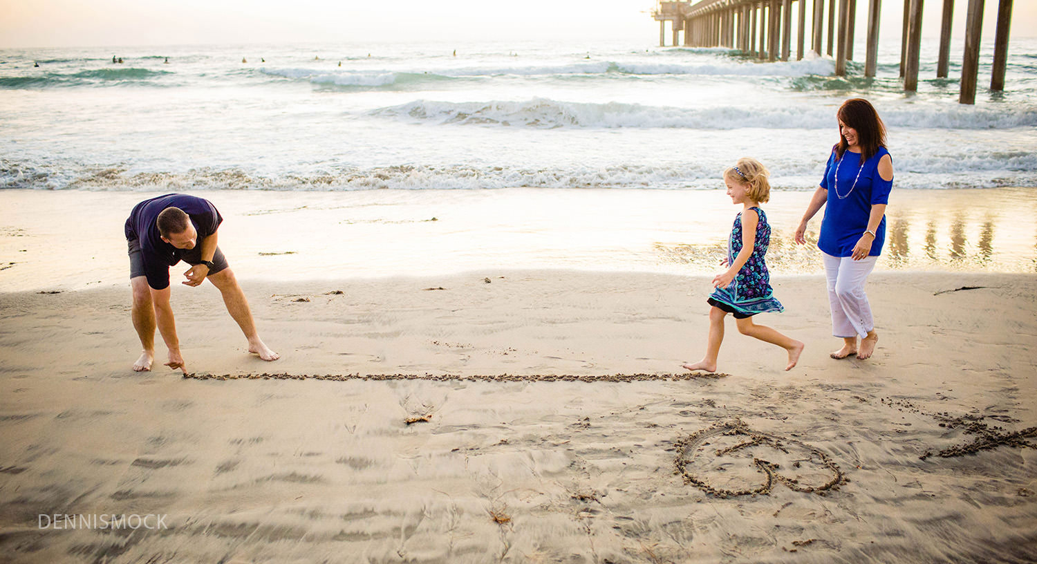 playing with their kids on a La Jolla family beach photo session