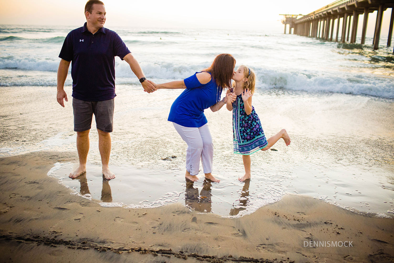 Giving mom some love as the waves run under my toes during San Diego beach photography