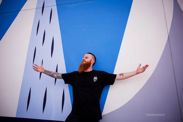 Awesome portrait against color wall by San Diego Photographer Dennis Mock