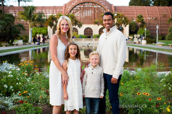 family playing and holding hands during a relax holiday family portrait session at San Diego's Balboa park