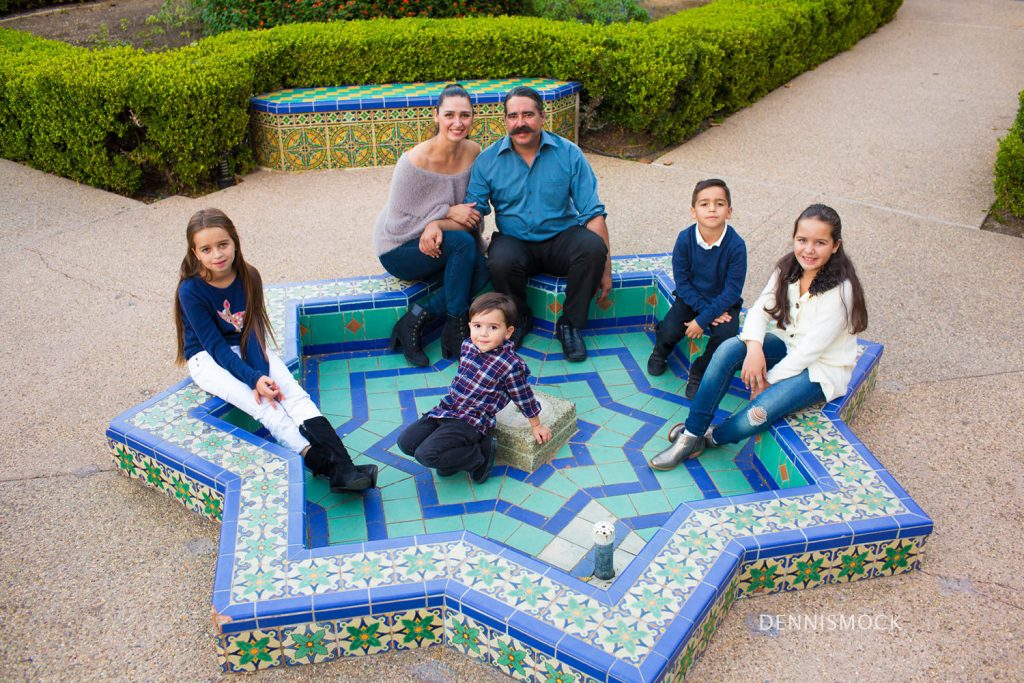 san Diego family photographed in one of Balboa parks beautiful gardens by Dennis mock photographer