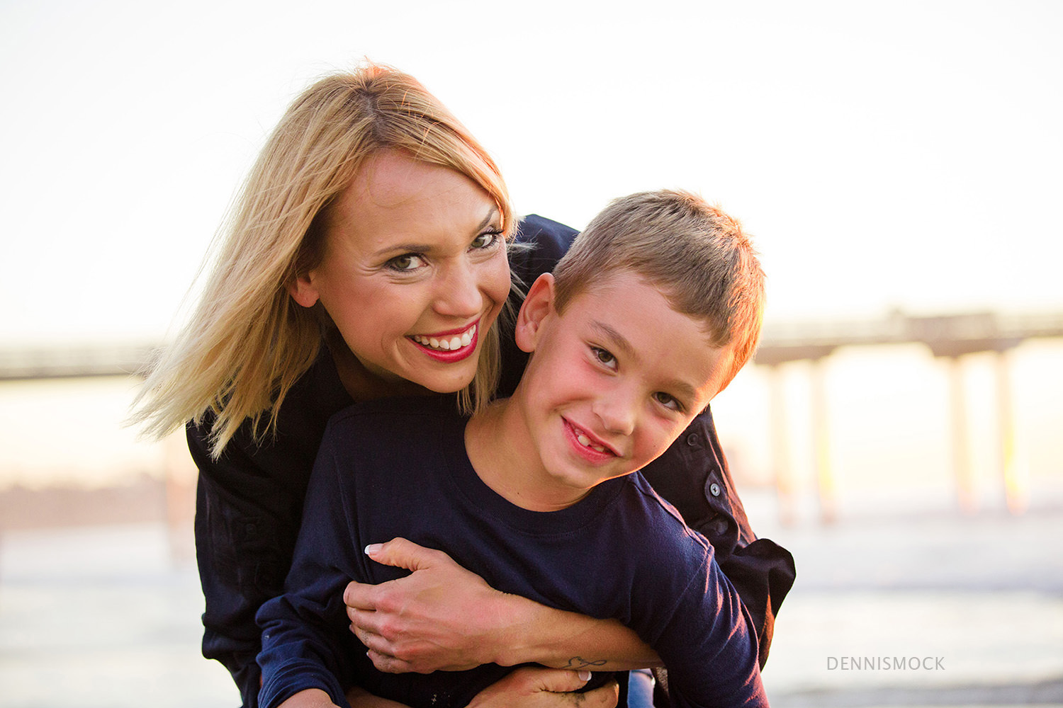beach hugs mother son at sunset Del Mar ca family portrait session