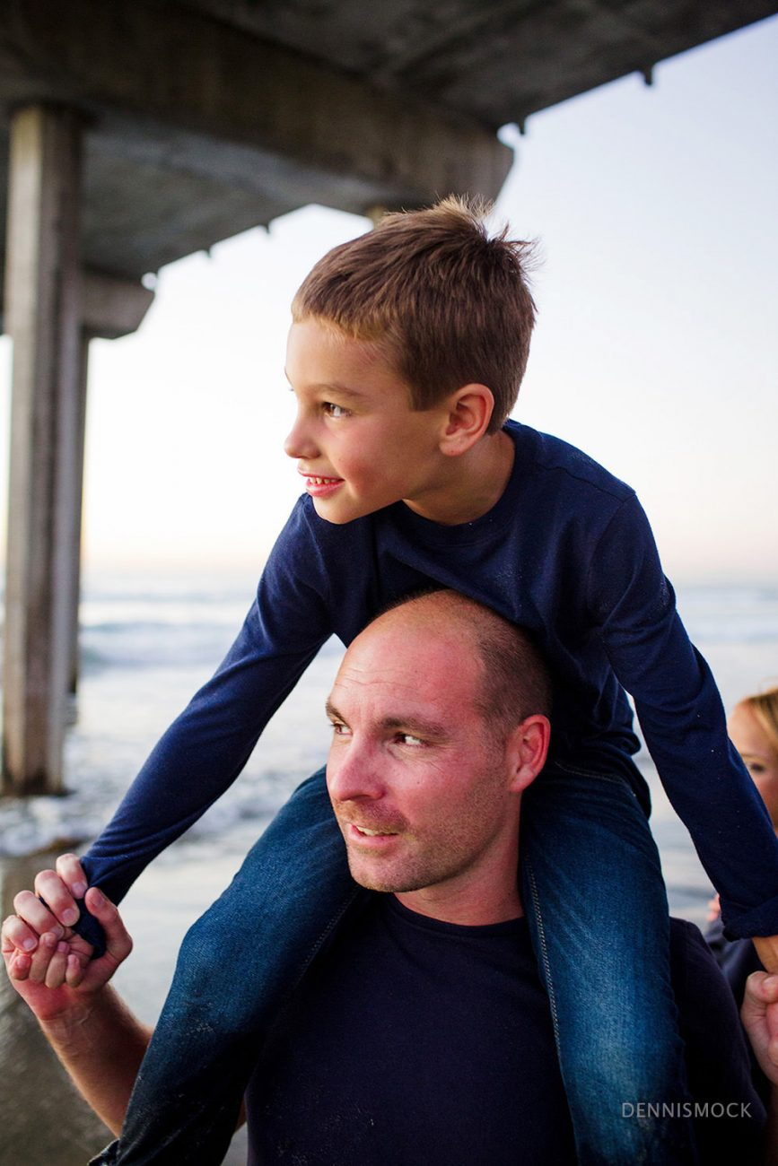 Father son moment captured during a beach portrait session with Dennis Mock Photographer