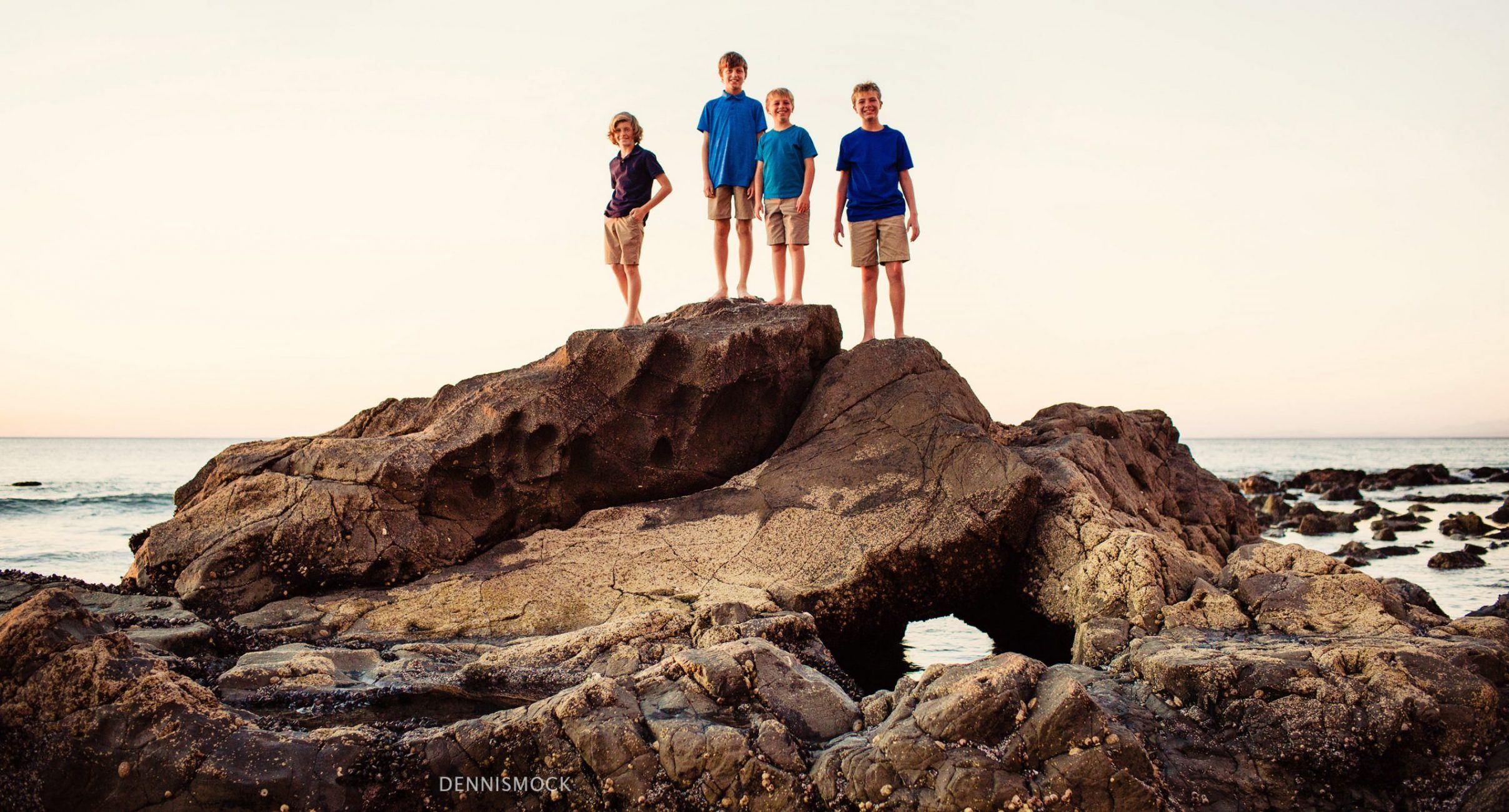 Boys exploring the low tide on a family portrait session at a San Diego beach