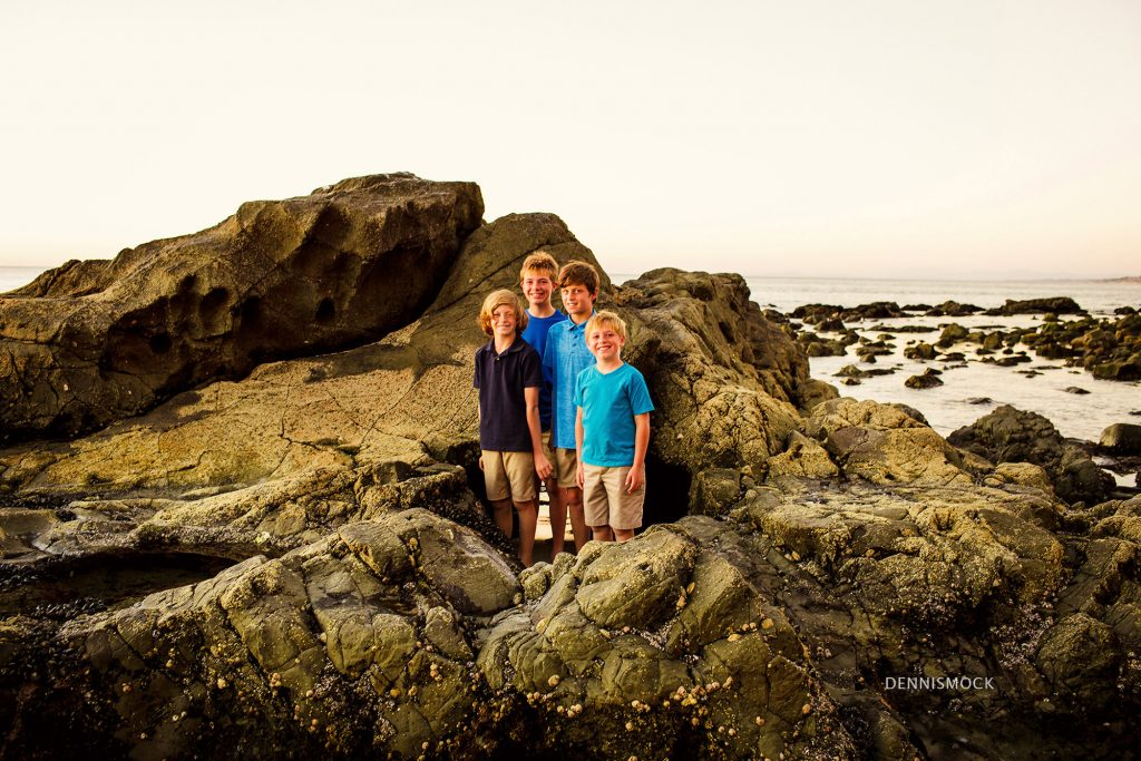 boys climbing rocks to catch the sunset at La Jolla Scripps pier. Photo by Dennis Mock Photographer