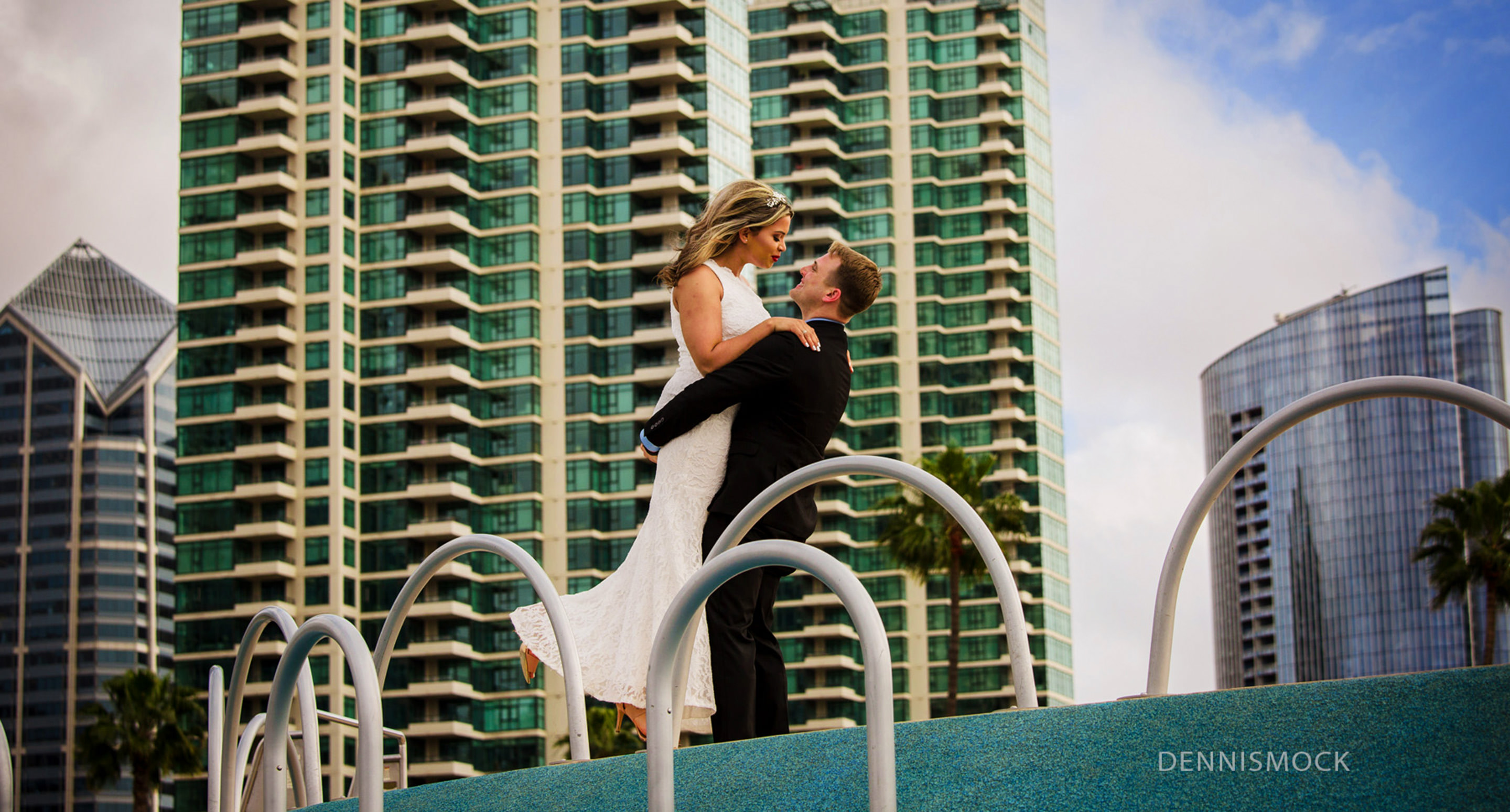 san Diego wedding couple hug with downtown city background by photographer Dennis mock