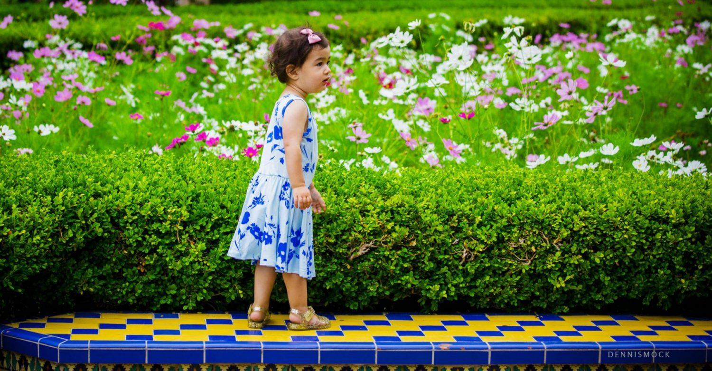 little girl exploring the flower gardens in Balboa park