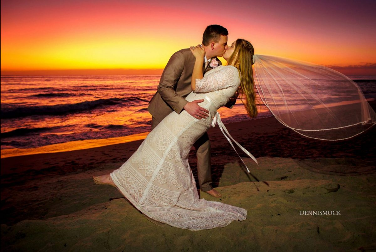 Colorful sunset kiss from San Diego Temple Wedding