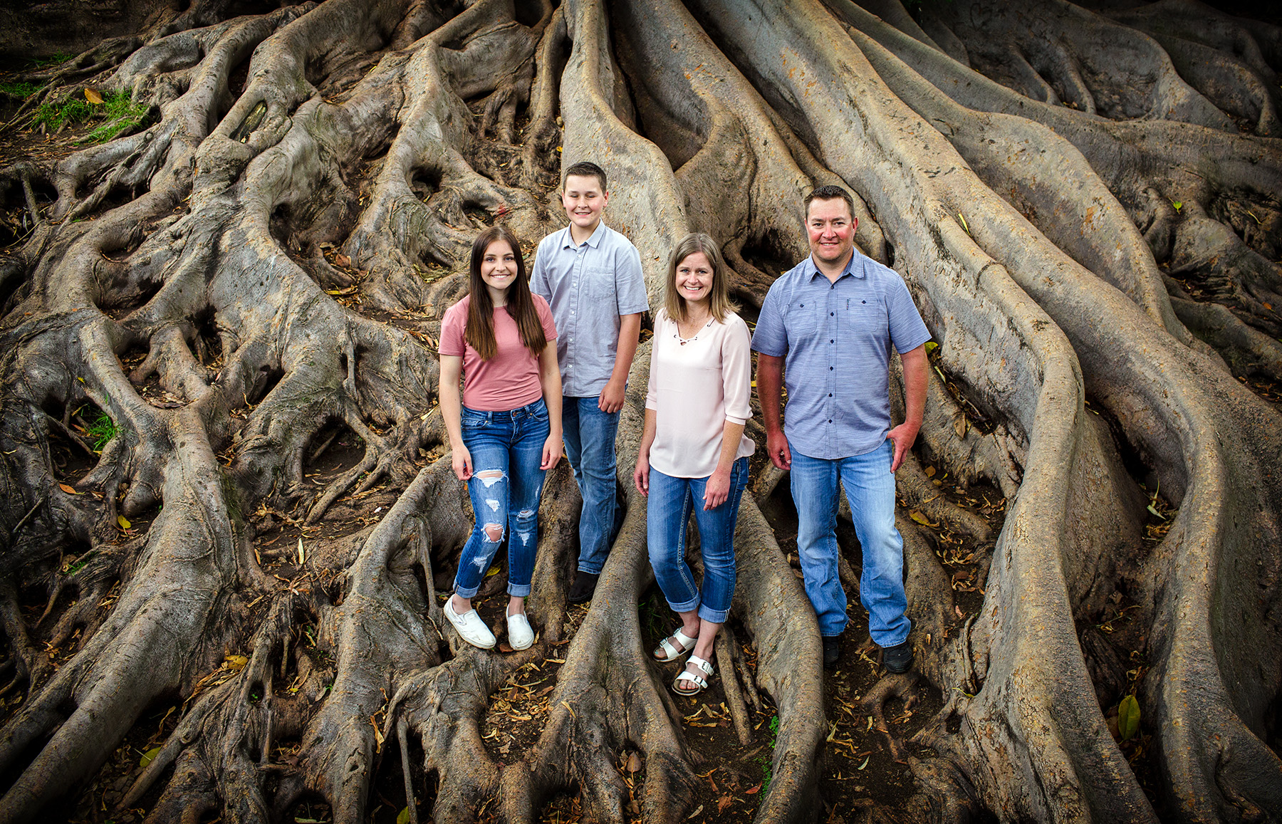 family portrait at Balboa Parks Giant Fig tree, the people love being here