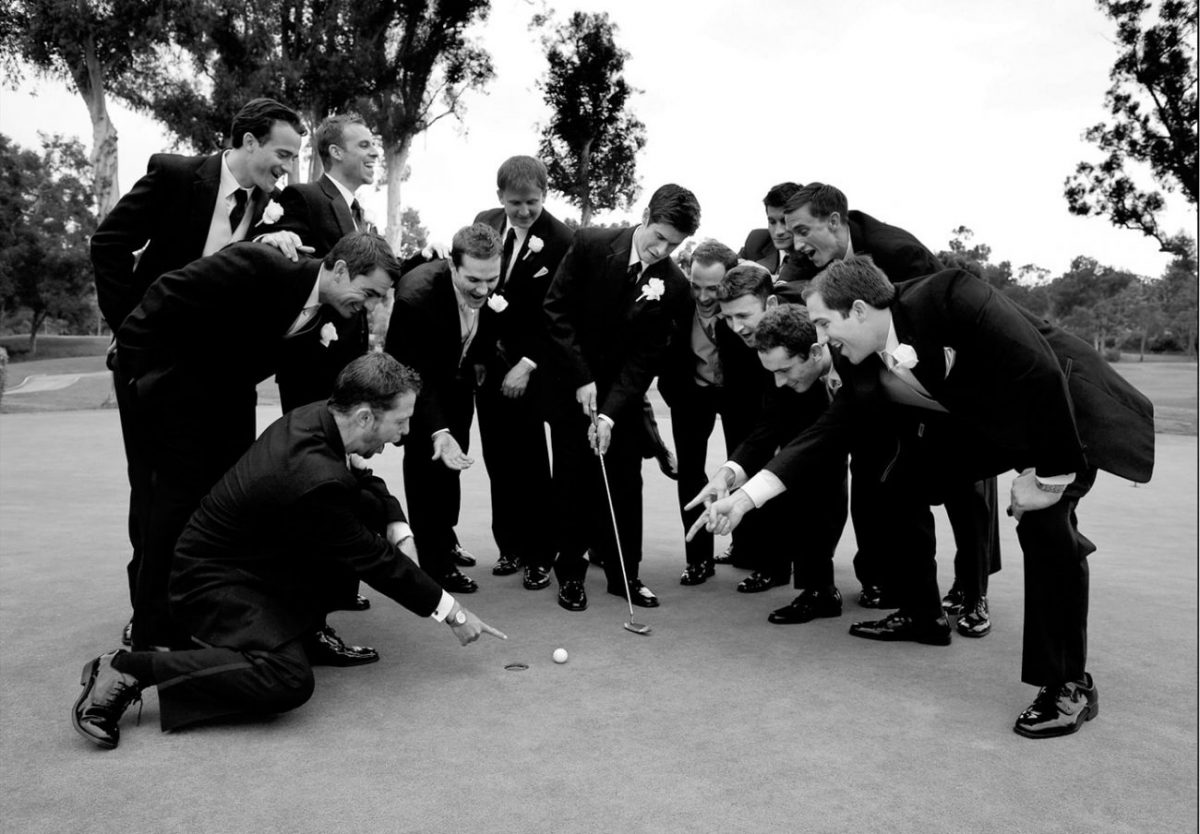 Groom playing golf with his guys capturing during the reception by San Diego photographer Dennis mock